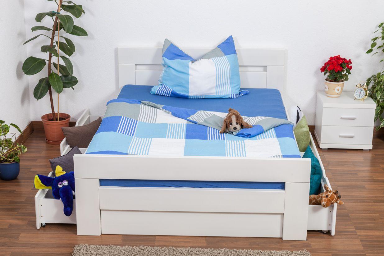 """Jugendbett """"Easy Premium Line"""" K6 inkl. 4 Schubladen und 2 Abdeckblenden 140 x 200 cm Buche Vollholz massiv weiß lackiert"""