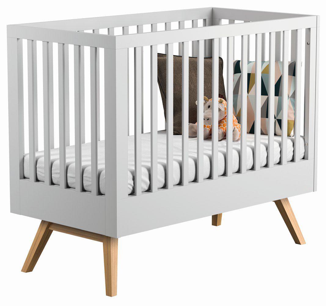 Babybett / Gitterbett Skady 02, Farbe: Weiß / Eiche - Liegefläche: 70 x 140 cm (B x L)